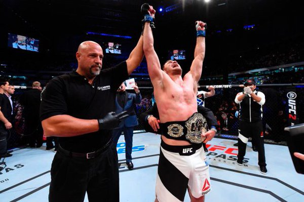 CURITIBA, BRAZIL - MAY 14: Stipe Miocic celebrates after defeating Fabricio Werdum of Brazil by KO in their UFC heavyweight championship bout during the UFC 198 event at Arena da Baixada stadium on May 14, 2016 in Curitiba, Parana, Brazil. (Photo by Josh Hedges/Zuffa LLC/Zuffa LLC via Getty Images)